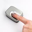Index finger on a biometric scanner