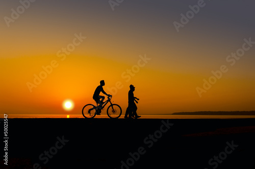 cyclist on sunset