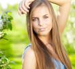 beautiful blonde in a spring garden