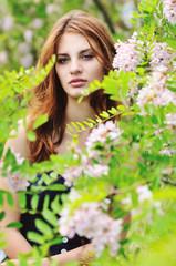 pensive girl near acacia