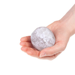 Woman's hand holding a halite salt ball