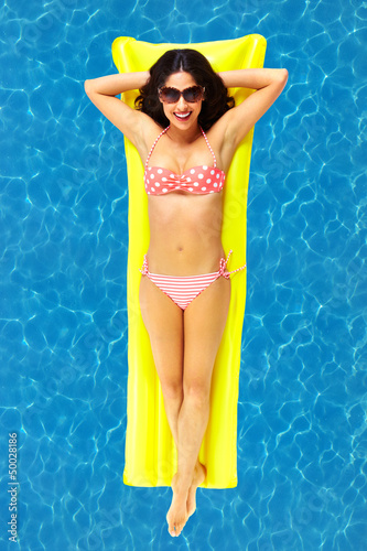 Woman relaxing in pool.