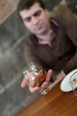 Tourist has degustation of brandy