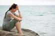Leinwanddruck Bild - Upset crying woman by the ocean