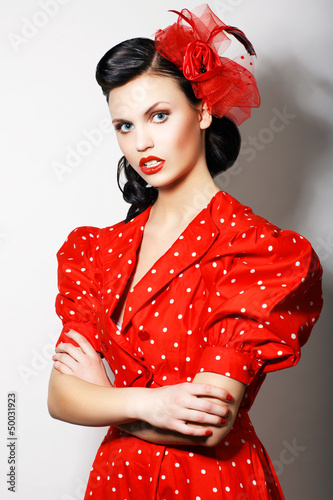 Strict Lady in Red Retro Dress - crossed hands. Proud Brunette