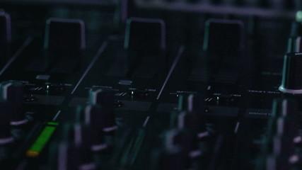 DJ using his mixer table