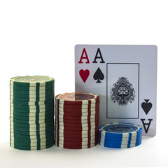 The poker cards with chips isolated in white