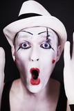 Funny screaming mime in white hat
