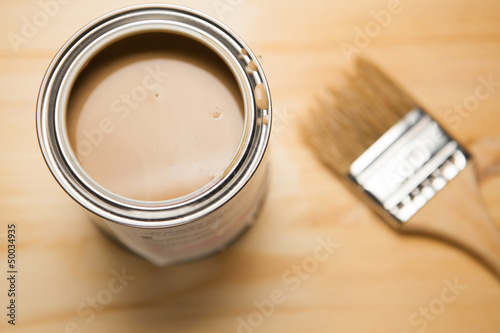 brown paint can and brush