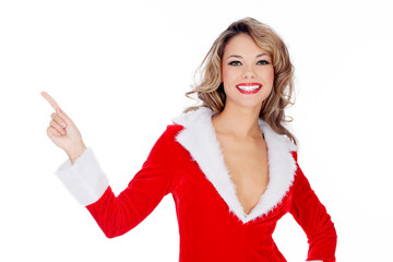 Santa Claus girl presenting something and pointing