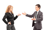 Businesswoman having an argument with a young businessman