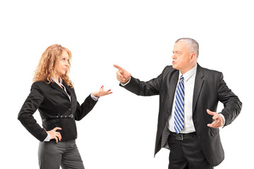 Mature man in a suit having a disagreement with a businesswoman