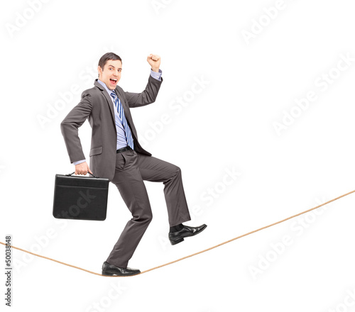 Full length portrait of a businessman gesturing happiness on a r