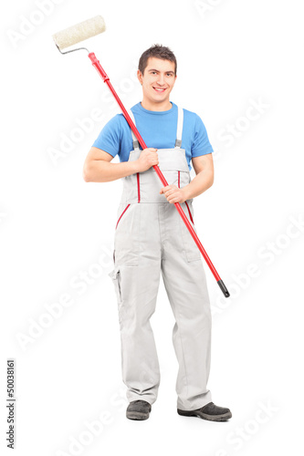 Full length portrait of a confident painter in a uniform with a