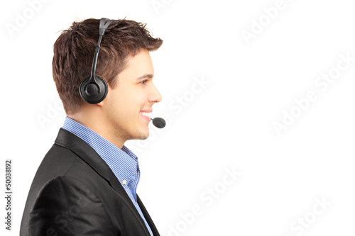 Smiling customer service employee in profile with headset on