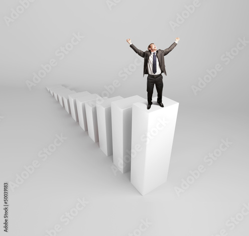 happy businnesman standing on column