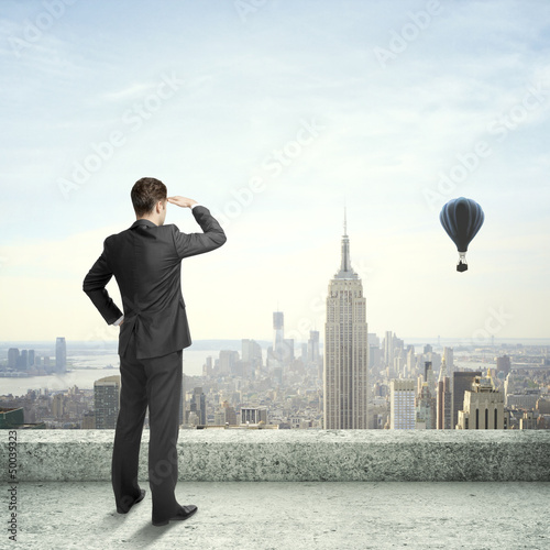 Businessman looking at city - 50039323
