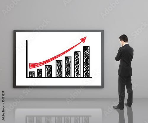 man looking at growth chart