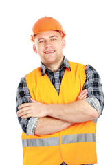 Smiling male construction worker in safety