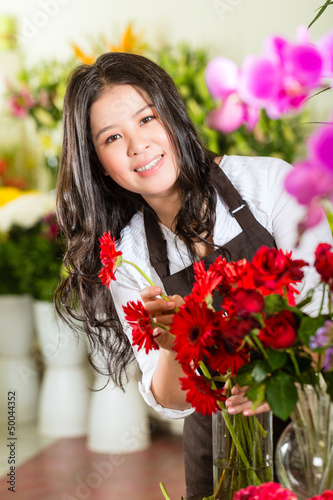 Chinese Saleswoman in a flower shop