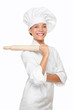 Baker woman smiling proud with baking rolling pin