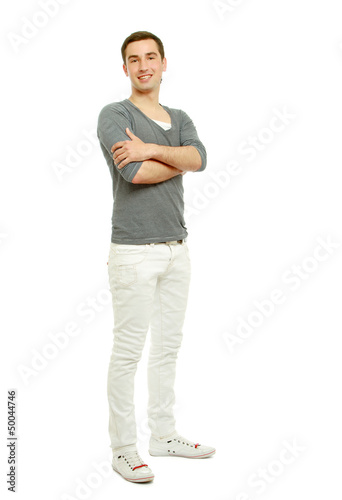 A handsome man standing isolated on white background