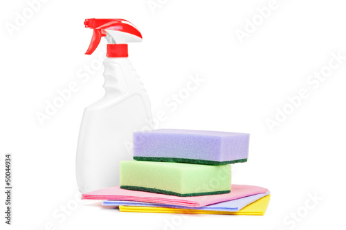 Studio shot of a cleaning spray and sponges