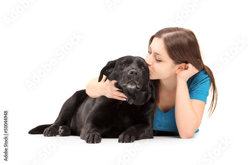 Young female hugging and kissing her dog