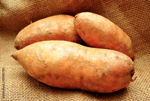 Three Sweet Potatoes on Burlap