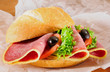 Sandwich roll with salami and olives