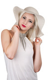 Beautiful young woman with diamond necklace and a hat