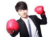 Asian businessman battle with boxing glove