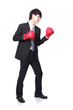 businessman battle with boxing glove