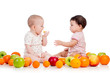 Two children kids eating together healthy food fruits isolated o