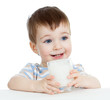 little child boy drinking yogurt or kefir over white