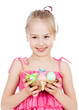 cute smiling kid girl holding Easter eggs in basket