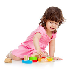cute kid girl playing with colorful toys, isolated on white back