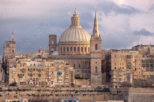 La Valletta View of the cupola St. Pauls Cathedral and belltower Charmelite Church at the evening
