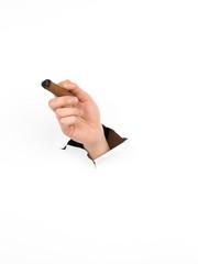 man's hand holding a cigar