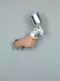 male hand holding a spray gun.