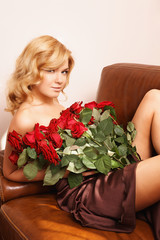 Young beautiful blonde woman with flowers