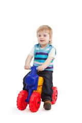 little boy in the bright bike
