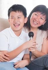 Asian family singing karaoke