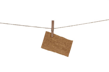 Blank paper cards hanging on clothespins