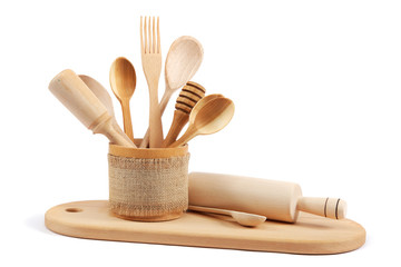 Wooden kitchen utensils isolated on white background.