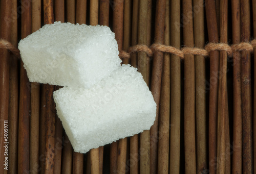Sugar lumps on wooden base