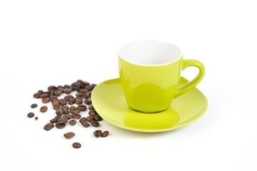 espressotasse grün mit kaffebohnen