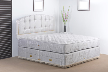 Luxury bedding mattress in a set up bedroom atmosphere