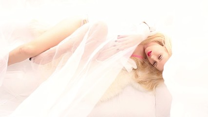 Pretty blonde in white bed, seen from above