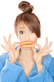 Woman with sausages simulating lip enhancement poster